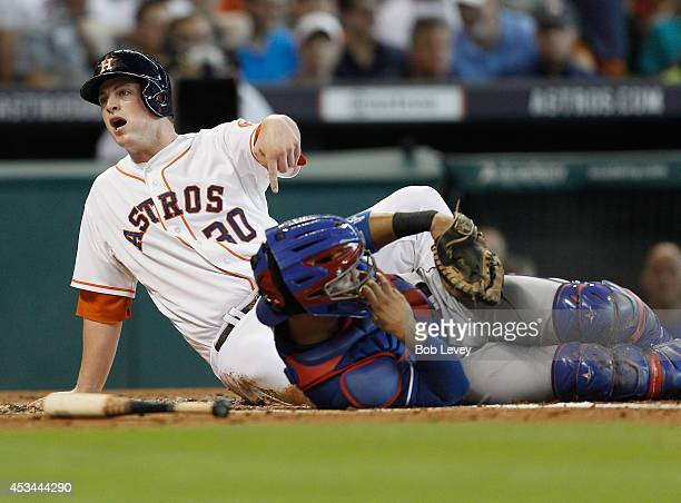 Matt Dominguez of the Houston Astros is tagged out at home by Robinson Chirinos of the Texas Rangers attempting to score in the second inning at...