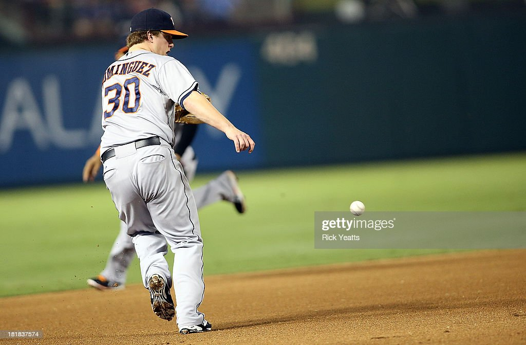 <a gi-track='captionPersonalityLinkClicked' href=/galleries/search?phrase=Matt+Dominguez&family=editorial&specificpeople=2934044 ng-click='$event.stopPropagation()'>Matt Dominguez</a> #30 of the Houston Astros makes the catch throwing to first base for the out on Adrian Beltre #29 of the Texas Rangers (not pictured) at Rangers Ballpark in Arlington on September 25, 2013 in Arlington, Texas.
