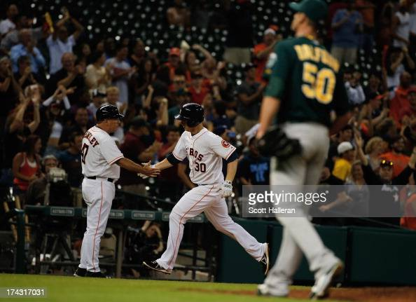 Matt Dominguez of the Houston Astros rounds third base after a tworun home run in the ninth inning off Grant Balfour of the Oakland Athletics at...