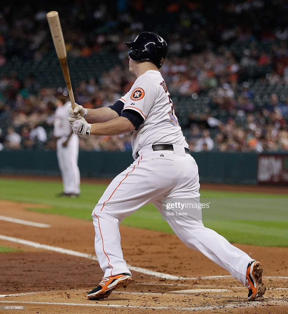 Matt Dominguez #30 of the Houston Astros singles in the first inning against the Seattle Mariners at Minute Maid Park on July 1, 2014 in Houston, Texas.