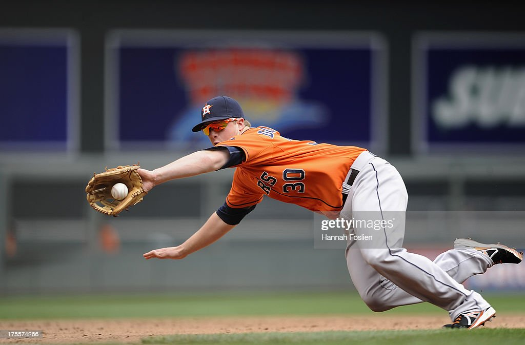<a gi-track='captionPersonalityLinkClicked' href=/galleries/search?phrase=Matt+Dominguez&family=editorial&specificpeople=2934044 ng-click='$event.stopPropagation()'>Matt Dominguez</a> #30 of the Houston Astros stops a ball hit by Doug Bernier #17 of the Minnesota Twins during the fifth inning of the game on August 4, 2013 at Target Field in Minneapolis, Minnesota.