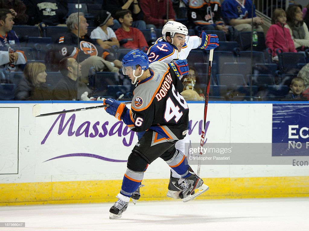 Matt Donovan #46 of the Bridgeport Sound Tigers is checked by Kyle Palmieri #21 of the Norfolk Admirals during an American Hockey League game on December 2, 2012 at the Webster Bank Arena in Bridgeport, Connecticut. The Admirals defeated the Sound Tigers 4-1.