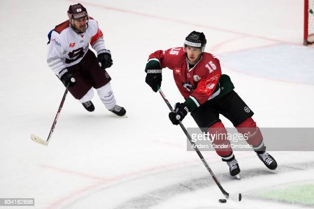 Matt Donovan skates with the puck during the Champions Hockey League Final between Frolunda Gothenburg and Sparta Prague at Frolundaborgs Isstadion...