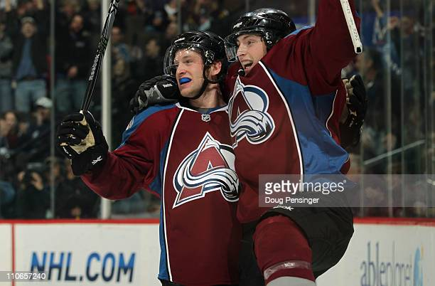 Matt Duchene of the Colorado Avalanche celebrates his third period goal with teammate Mark Oliver to tie the score 33 in the third period against the...