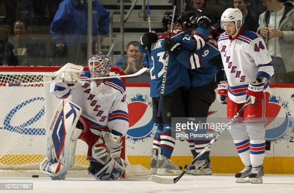 Matt Duchene and Milan Hejduk of the Colorado Avalanche congratulate Kevin Porter for his second period goal against goalie Henrik Lundqvist of the...