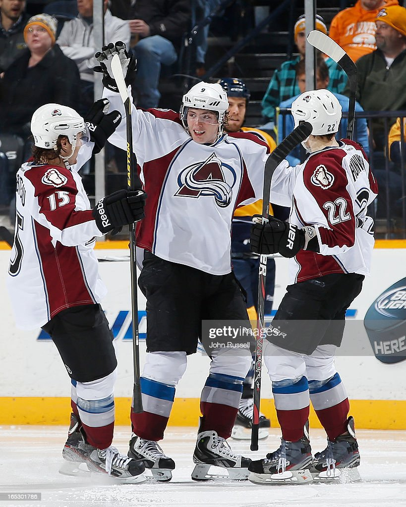<a gi-track='captionPersonalityLinkClicked' href=/galleries/search?phrase=Matt+Duchene&family=editorial&specificpeople=4819304 ng-click='$event.stopPropagation()'>Matt Duchene</a> #9 celebrates his goal with PA Parenteau #15 and <a gi-track='captionPersonalityLinkClicked' href=/galleries/search?phrase=Matt+Hunwick&family=editorial&specificpeople=2284766 ng-click='$event.stopPropagation()'>Matt Hunwick</a> #22 of the Colorado Avalanche against the Nashville Predators during an NHL game at the Bridgestone Arena on April 2, 2013 in Nashville, Tennessee.