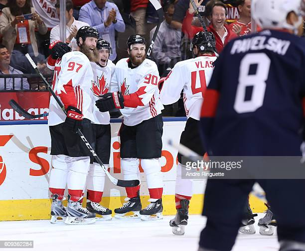 Matt Duchene celebrates with Joe Thornton Ryan O'Reilly and MarcEdouard Vlasic of Team Canada after scoring a first period goal on Team USA during...