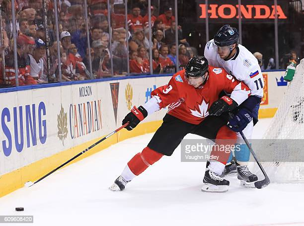 Matt Duchene of Team Canada pulls the puck away from Anze Kopitar of Team Europe during the World Cup of Hockey 2016 at Air Canada Centre on...