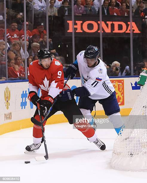 Matt Duchene of Team Canada stickhandles the puck with Anze Kopitar of Team Europe chasing during the World Cup of Hockey 2016 at Air Canada Centre...