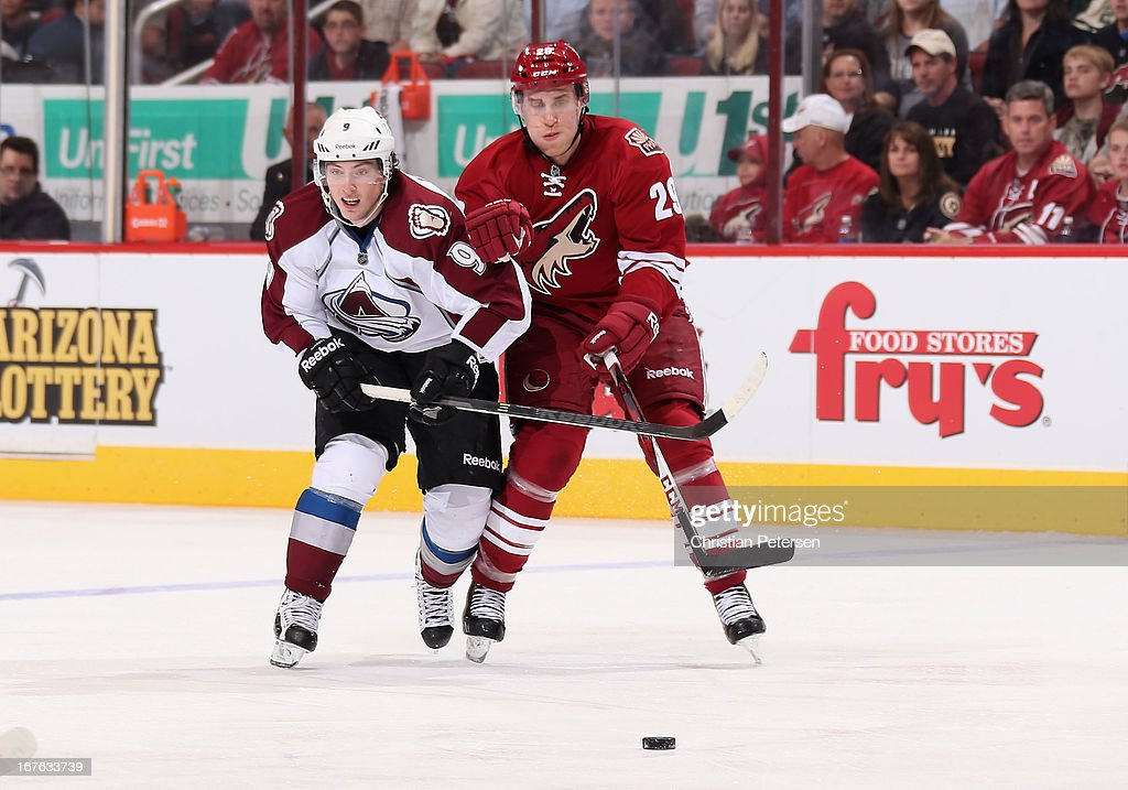 <a gi-track='captionPersonalityLinkClicked' href=/galleries/search?phrase=Matt+Duchene&family=editorial&specificpeople=4819304 ng-click='$event.stopPropagation()'>Matt Duchene</a> #9 of the Colorado Avalanche and Michael Stone #29 of the Phoenix Coyotes skate after a loose puck during the NHL game at Jobing.com Arena on April 26, 2013 in Glendale, Arizona. The Avalanche defeated the Coyotes 5-4 in an overtime shoot-out.