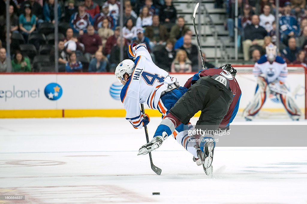 <a gi-track='captionPersonalityLinkClicked' href=/galleries/search?phrase=Matt+Duchene&family=editorial&specificpeople=4819304 ng-click='$event.stopPropagation()'>Matt Duchene</a> #9 of the Colorado Avalanche and <a gi-track='captionPersonalityLinkClicked' href=/galleries/search?phrase=Taylor+Hall&family=editorial&specificpeople=2808377 ng-click='$event.stopPropagation()'>Taylor Hall</a> #4 of the Edmonton Oilers fall as they collide in the neutral zone during a game at the Pepsi Center on February 2, 2013 in Denver, Colorado. The Avalanche beat the Oilers 3-1.
