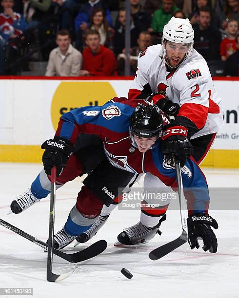 Matt Duchene of the Colorado Avalanche battles to control the puck against Jared Cowen of the Ottawa Senators at Pepsi Center on January 8 2014 in...