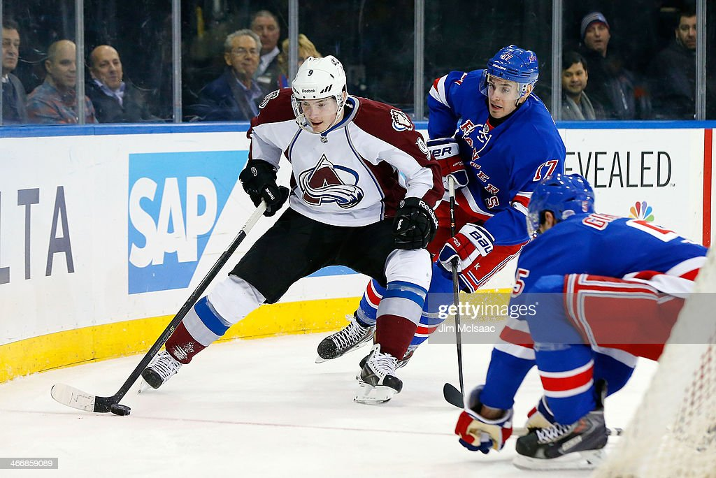 Matt Duchene #9 of the Colorado Avalanche carries the puck behind the net during the first period against John Moore #17 of the New York Rangers at Madison Square Garden on February 4, 2014 in New York City.