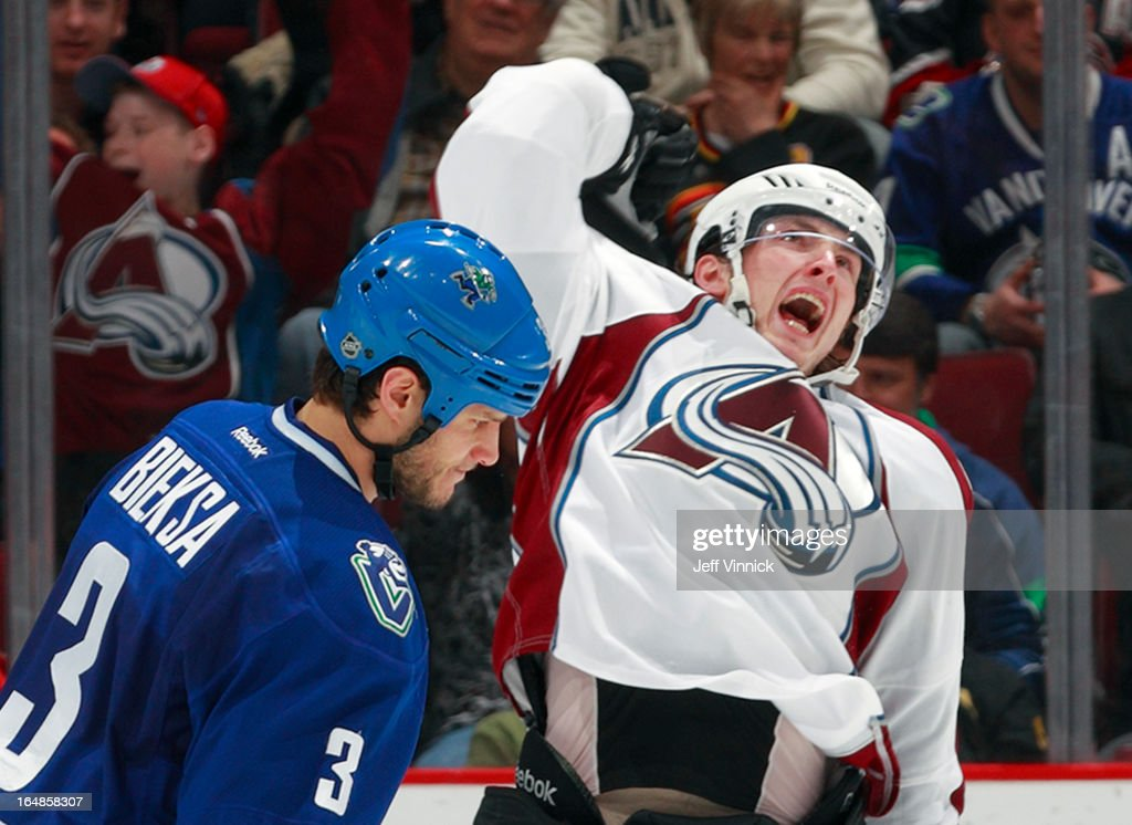 <a gi-track='captionPersonalityLinkClicked' href=/galleries/search?phrase=Matt+Duchene&family=editorial&specificpeople=4819304 ng-click='$event.stopPropagation()'>Matt Duchene</a> #9 of the Colorado Avalanche celebrates a goal while <a gi-track='captionPersonalityLinkClicked' href=/galleries/search?phrase=Kevin+Bieksa&family=editorial&specificpeople=688792 ng-click='$event.stopPropagation()'>Kevin Bieksa</a> #3 of the Vancouver Canucks looks down during their NHL game at Rogers Arena March 28, 2013 in Vancouver, British Columbia, Canada. Vancouver won 4-1.