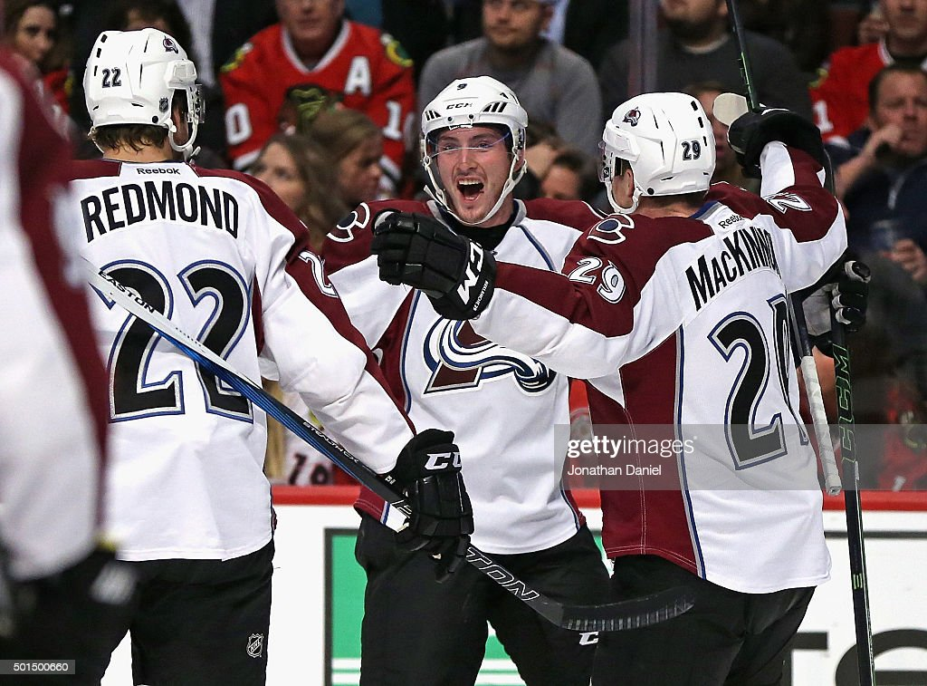 <a gi-track='captionPersonalityLinkClicked' href=/galleries/search?phrase=Matt+Duchene&family=editorial&specificpeople=4819304 ng-click='$event.stopPropagation()'>Matt Duchene</a> #9 of the Colorado Avalanche (center) celebrates his first period goal with teammates <a gi-track='captionPersonalityLinkClicked' href=/galleries/search?phrase=Zach+Redmond&family=editorial&specificpeople=8234699 ng-click='$event.stopPropagation()'>Zach Redmond</a> #22 and <a gi-track='captionPersonalityLinkClicked' href=/galleries/search?phrase=Nathan+MacKinnon&family=editorial&specificpeople=8610127 ng-click='$event.stopPropagation()'>Nathan MacKinnon</a> #29 against the Chicago Blackhawks at the United Center on December 15, 2015 in Chicago, Illinois.