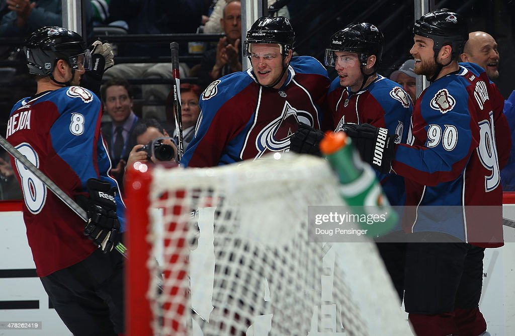 Matt Duchene #9 of the Colorado Avalanche celebrates his goal against the Chicago Blackhawks with Jan Hejda #8, Jamie McGinn #11 and Ryan O'Reilly #90 of the Colorado Avalanche to take a 2-0 lead in the second period at Pepsi Center on March 12, 2014 in Denver, Colorado.