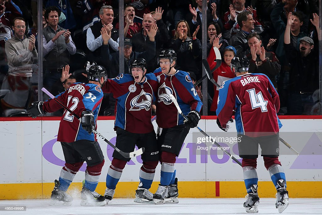 Matt Duchene #9 of the Colorado Avalanche celebrates his goal against the Calgary Flames with Francois Beauchemin #32, Mikhail Grigorenko #25 and Tyson Barrie #4 of the Colorado Avalanche to take a 5-3 lead in the third period at Pepsi Center on November 3, 2015 in Denver, Colorado. The Avalanche defeated the Flames 6-3.