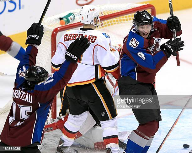 Matt Duchene of the Colorado Avalanche celebrates his goal with teammate PA Parenteau of the Colorado Avalanche after scoring what would become the...