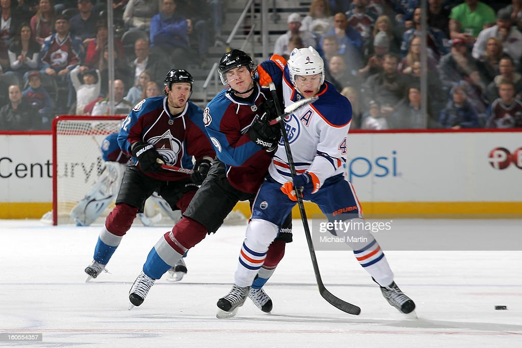 <a gi-track='captionPersonalityLinkClicked' href=/galleries/search?phrase=Matt+Duchene&family=editorial&specificpeople=4819304 ng-click='$event.stopPropagation()'>Matt Duchene</a> #9 of the Colorado Avalanche collides with <a gi-track='captionPersonalityLinkClicked' href=/galleries/search?phrase=Taylor+Hall&family=editorial&specificpeople=2808377 ng-click='$event.stopPropagation()'>Taylor Hall</a> #4 of the Edmonton Oilers at the Pepsi Center on February 2, 2013 in Denver, Colorado. The Avalanche went on to win 3-1.