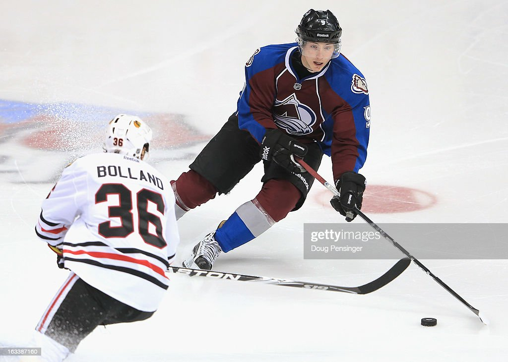 <a gi-track='captionPersonalityLinkClicked' href=/galleries/search?phrase=Matt+Duchene&family=editorial&specificpeople=4819304 ng-click='$event.stopPropagation()'>Matt Duchene</a> #9 of the Colorado Avalanche controls the puck against Dave Bolland #36 of the Chicago Blackhawks at the Pepsi Center on March 8, 2013 in Denver, Colorado. The Avalanche defeated the Blackhawks 6-2 to end the Chicago's 30 game undefeated streak.