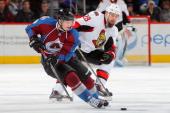 Matt Duchene of the Colorado Avalanche controls the puck against Matt Kassian of the Ottawa Senators at Pepsi Center on January 8 2014 in Denver...