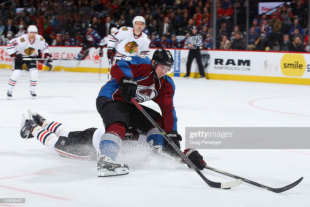 <a gi-track='captionPersonalityLinkClicked' href=/galleries/search?phrase=Matt+Duchene&family=editorial&specificpeople=4819304 ng-click='$event.stopPropagation()'>Matt Duchene</a> #9 of the Colorado Avalanche controls the puck against the defense of <a gi-track='captionPersonalityLinkClicked' href=/galleries/search?phrase=Johnny+Oduya&family=editorial&specificpeople=3944055 ng-click='$event.stopPropagation()'>Johnny Oduya</a> #27 of the Chicago Blackhawks at Pepsi Center on March 12, 2014 in Denver, Colorado.