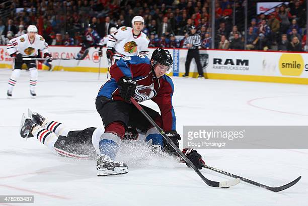 Matt Duchene of the Colorado Avalanche controls the puck against the defense of Johnny Oduya of the Chicago Blackhawks at Pepsi Center on March 12...