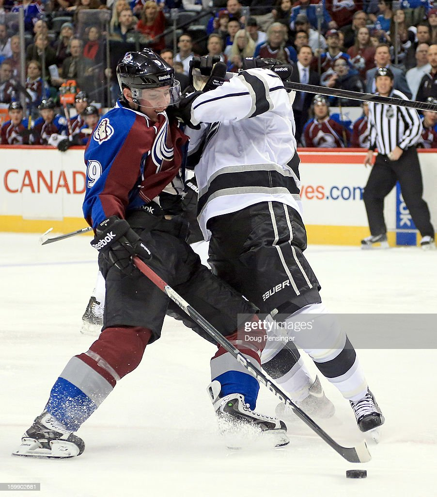 <a gi-track='captionPersonalityLinkClicked' href=/galleries/search?phrase=Matt+Duchene&family=editorial&specificpeople=4819304 ng-click='$event.stopPropagation()'>Matt Duchene</a> #9 of the Colorado Avalanche controls the puck on a short handed breakaway and <a gi-track='captionPersonalityLinkClicked' href=/galleries/search?phrase=Alec+Martinez+-+Ice+Hockey+Player&family=editorial&specificpeople=5537193 ng-click='$event.stopPropagation()'>Alec Martinez</a> #27 of the Los Angeles Kings is penalized for holding as he defends in the second period at the Pepsi Center on January 22, 2013 in Denver, Colorado.