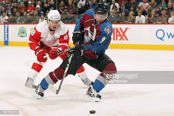 Matt Duchene of the Colorado Avalanche controls the puck while under pressure from Justin Abdelkader of the Detroit Red Wings at the Pepsi Center on...