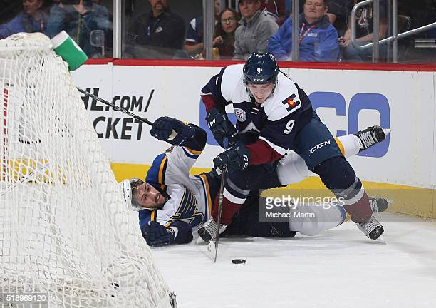 Matt Duchene of the Colorado Avalanche fights for position against Robert Bortuzzo of the St Louis Blues at the Pepsi Center on April 03 2016 in...