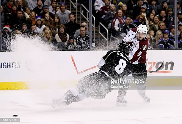 Matt Duchene of the Colorado Avalanche gets the puck past Drew Doughty of the Los Angeles Kings at Staples Center on December 21 2013 in Los Angeles...