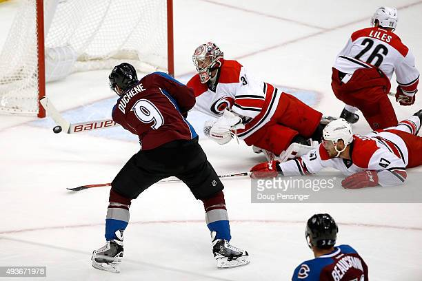 Matt Duchene of the Colorado Avalanche has his shot deflected by goalie Cam Ward of the Carolina Hurricanes as he makes a stick save in the third...