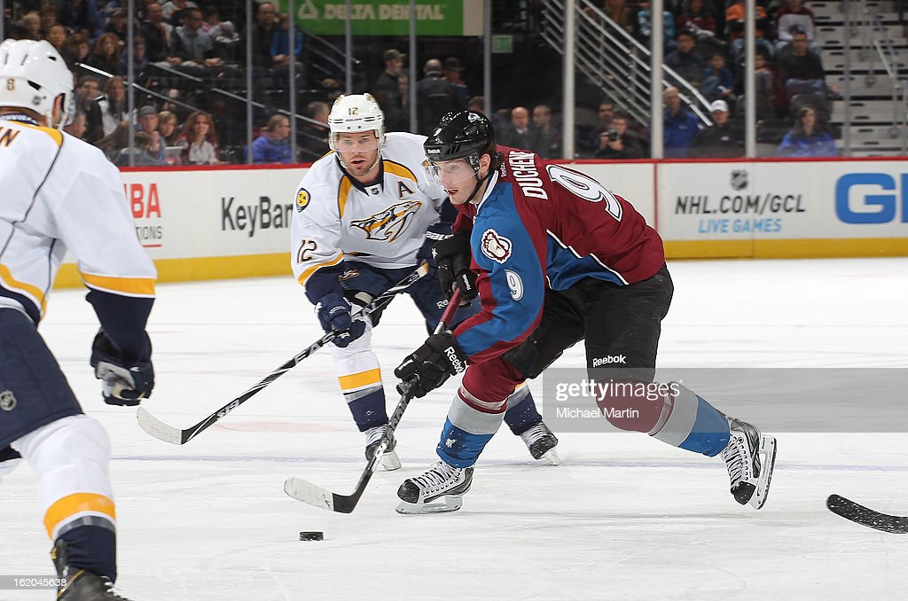 <a gi-track='captionPersonalityLinkClicked' href=/galleries/search?phrase=Matt+Duchene&family=editorial&specificpeople=4819304 ng-click='$event.stopPropagation()'>Matt Duchene</a> #9 of the Colorado Avalanche skates against <a gi-track='captionPersonalityLinkClicked' href=/galleries/search?phrase=Mike+Fisher+-+Ice+Hockey+Player&family=editorial&specificpeople=204732 ng-click='$event.stopPropagation()'>Mike Fisher</a> #12 of the Nashville Predators at the Pepsi Center on February 18, 2013 in Denver, Colorado.