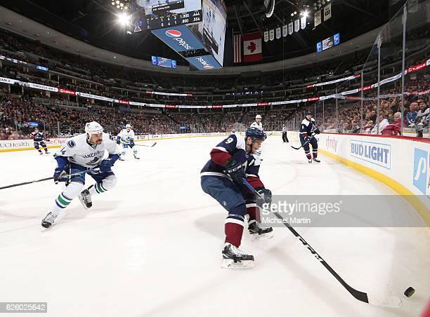 Matt Duchene of the Colorado Avalanche skates in the corner against Erik Gudbranson of the Vancouver Canucks at the Pepsi Center on November 26 2016...