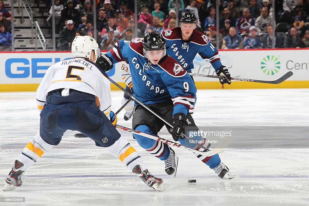 <a gi-track='captionPersonalityLinkClicked' href=/galleries/search?phrase=Matt+Duchene&family=editorial&specificpeople=4819304 ng-click='$event.stopPropagation()'>Matt Duchene</a> #9 of the Colorado Avalanche skates the puck against Chad Ruhwedel #5 of the Buffalo Sabres at the Pepsi Center on February 1, 2014 in Denver, Colorado. The Avalanche defeated the Sabres 7-1.