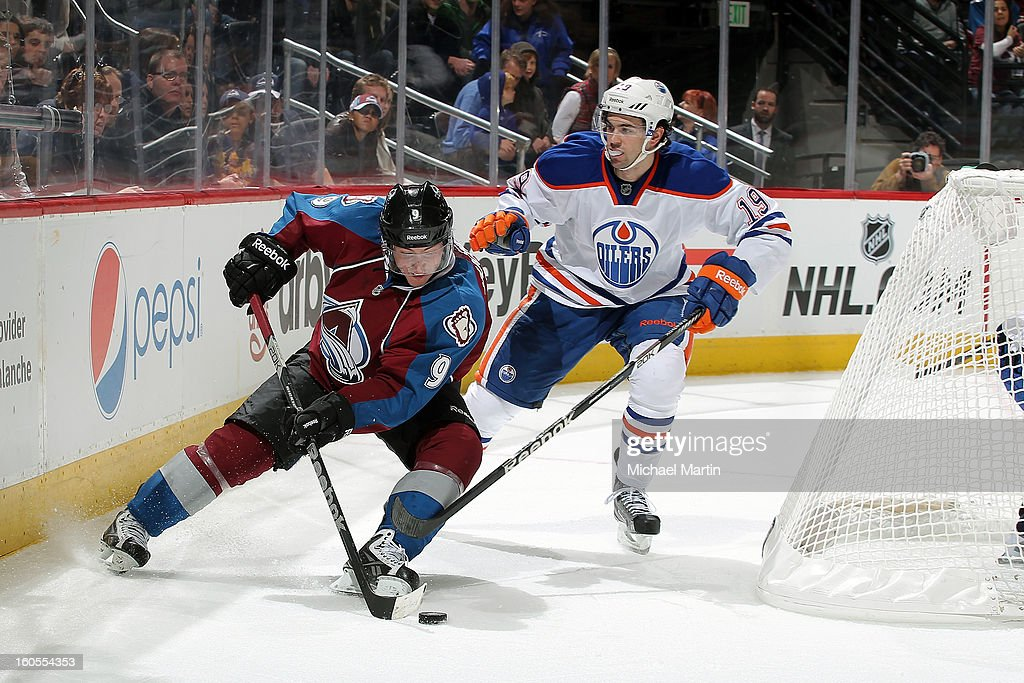 <a gi-track='captionPersonalityLinkClicked' href=/galleries/search?phrase=Matt+Duchene&family=editorial&specificpeople=4819304 ng-click='$event.stopPropagation()'>Matt Duchene</a> #9 of the Colorado Avalanche skates the puck around the net as Justin Schultz #19 the Edmonton Oilers defends at the Pepsi Center on February 2, 2013 in Denver, Colorado. Colorado went on to win 3-1.