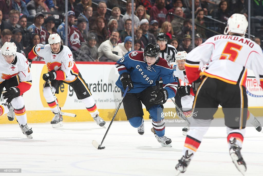 <a gi-track='captionPersonalityLinkClicked' href=/galleries/search?phrase=Matt+Duchene&family=editorial&specificpeople=4819304 ng-click='$event.stopPropagation()'>Matt Duchene</a> #9 of the Colorado Avalanche skates with the puck as members of the Calgary Flames close in at the Pepsi Center on January 06, 2014 in Denver, Colorado. The Flames defeated the Avalanche 4-3.
