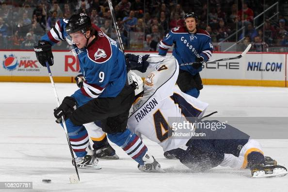 Matt Duchene of the Colorado Avalanche steals the puck from Cody Franson of the Nashville Predators at the Pepsi Center on January 20 2011 in Denver...