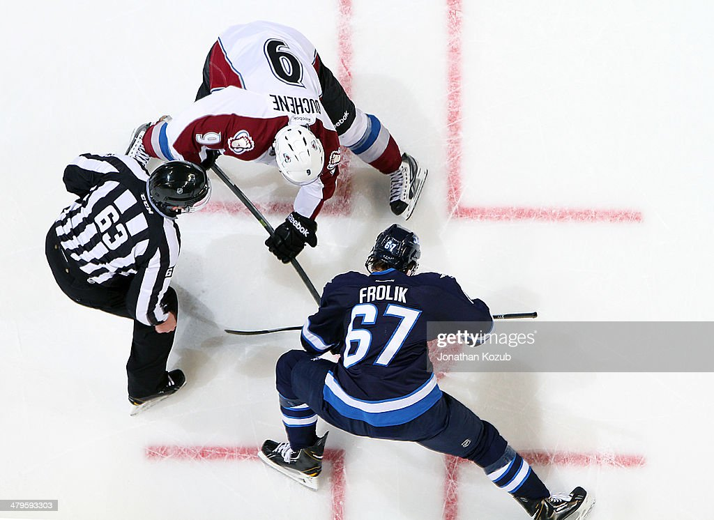 <a gi-track='captionPersonalityLinkClicked' href=/galleries/search?phrase=Matt+Duchene&family=editorial&specificpeople=4819304 ng-click='$event.stopPropagation()'>Matt Duchene</a> #9 of the Colorado Avalanche takes a second period face-off against <a gi-track='captionPersonalityLinkClicked' href=/galleries/search?phrase=Michael+Frolik&family=editorial&specificpeople=537965 ng-click='$event.stopPropagation()'>Michael Frolik</a> #67 of the Winnipeg Jets at the MTS Centre on March 19, 2014 in Winnipeg, Manitoba, Canada.