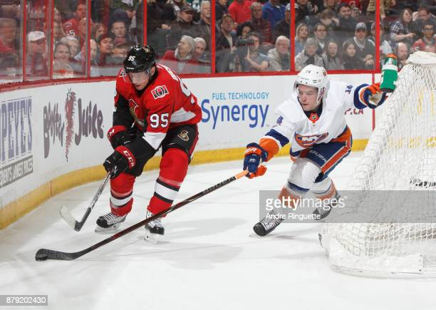 Matt Duchene of the Ottawa Senators battles for puck possession against Thomas Hickey of the New York Islanders behind the net at Canadian Tire...
