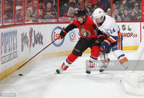 Matt Duchene of the Ottawa Senators controls the puck behind the net against Thomas Hickey of the New York Islanders at Canadian Tire Centre on...