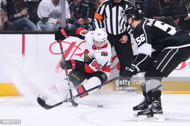 Matt Duchene of the Ottawa Senators handles the puck against Kurtis MacDermid of the Los Angeles Kings at STAPLES Center on December 7 2017 in Los...