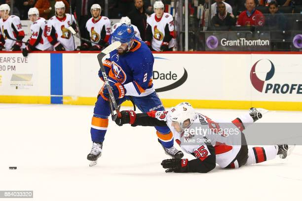 Matt Duchene of the Ottawa Senators slides to block a shot by Nick Leddy of the New York Islanders during the waning seconds of a 65 win at Barclays...