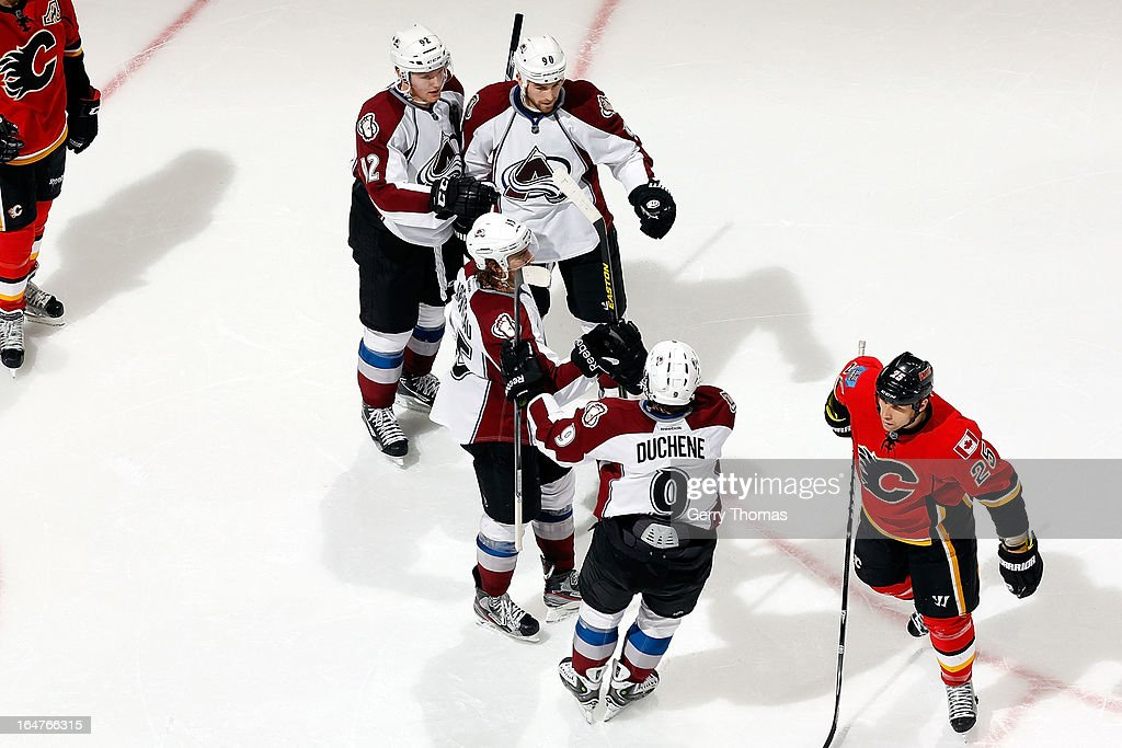<a gi-track='captionPersonalityLinkClicked' href=/galleries/search?phrase=Matt+Duchene&family=editorial&specificpeople=4819304 ng-click='$event.stopPropagation()'>Matt Duchene</a> #9, <a gi-track='captionPersonalityLinkClicked' href=/galleries/search?phrase=Ryan+O%27Reilly&family=editorial&specificpeople=4754037 ng-click='$event.stopPropagation()'>Ryan O'Reilly</a> #90 and teammates of the Colorado Avalanche celebrate a goal against the Calgary Flames on March 27, 2013 at the Scotiabank Saddledome in Calgary, Alberta, Canada.