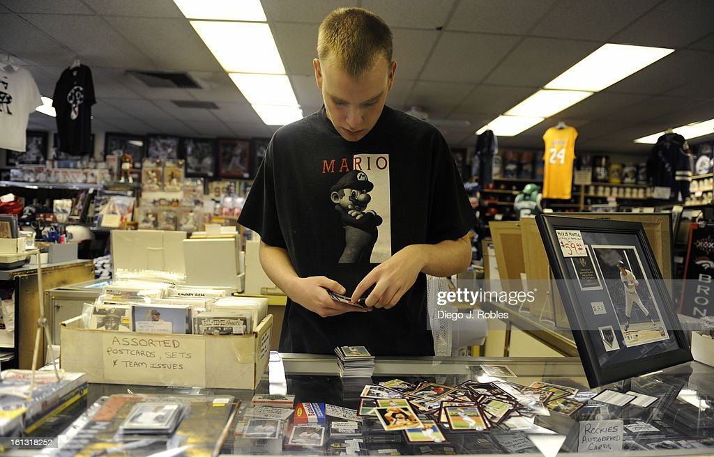 Matt Duerksen, an employee for the past two years at Bill's Sports Collectibles store in Denver, organizes baseball cards on Friday afternoon, May 28, 2010. Duerksen says his 1933 Goudey Babe Ruth card is his most valuable. Diego James Robles, The Denver Post