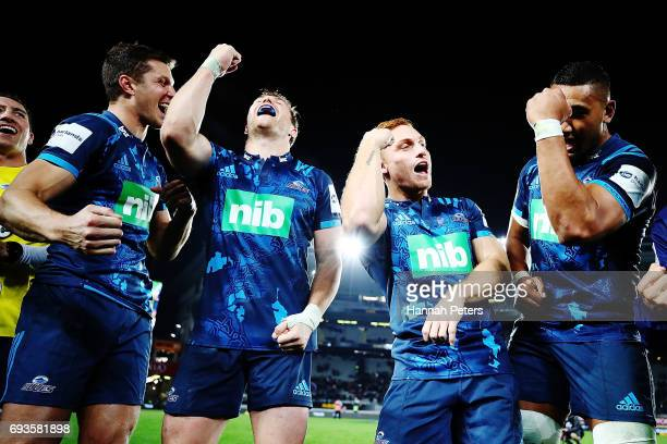 Matt Duffie Michael Collins Ihaia Westand Jimmy Tupou celebrate after winning the match between the Auckland Blues and the British Irish Lions at...