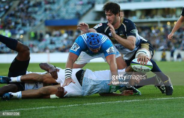 Matt Duffie of the Blues heads to the try line to score during the round 10 Super Rugby match between the Brumbies and the Blues at GIO Stadium on...