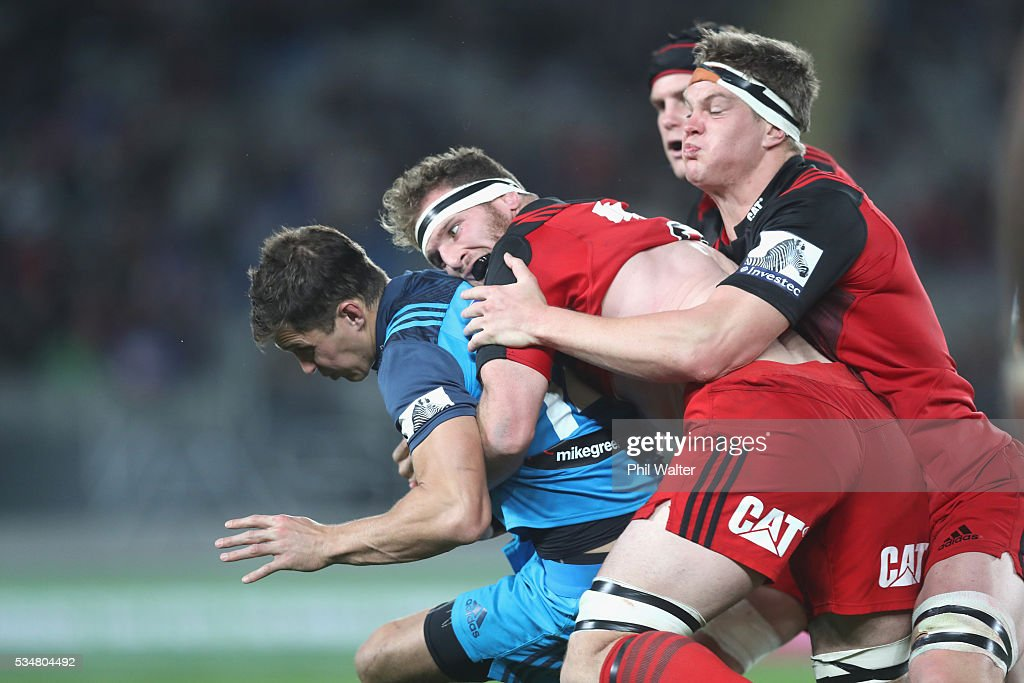 Matt Duffie of the Blues is tackled by <a gi-track='captionPersonalityLinkClicked' href=/galleries/search?phrase=Kieran+Read&family=editorial&specificpeople=789465 ng-click='$event.stopPropagation()'>Kieran Read</a> of the Crusaders during the round 14 Super Rugby match between the Blues and the Crusaders at Eden Park on May 28, 2016 in Auckland, New Zealand.