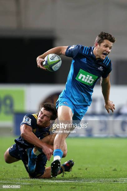 Matt Duffie of the Blues tries to break a tackle during the round seven Super Rugby match between the Highlanders and the Blues on April 8 2017 in...