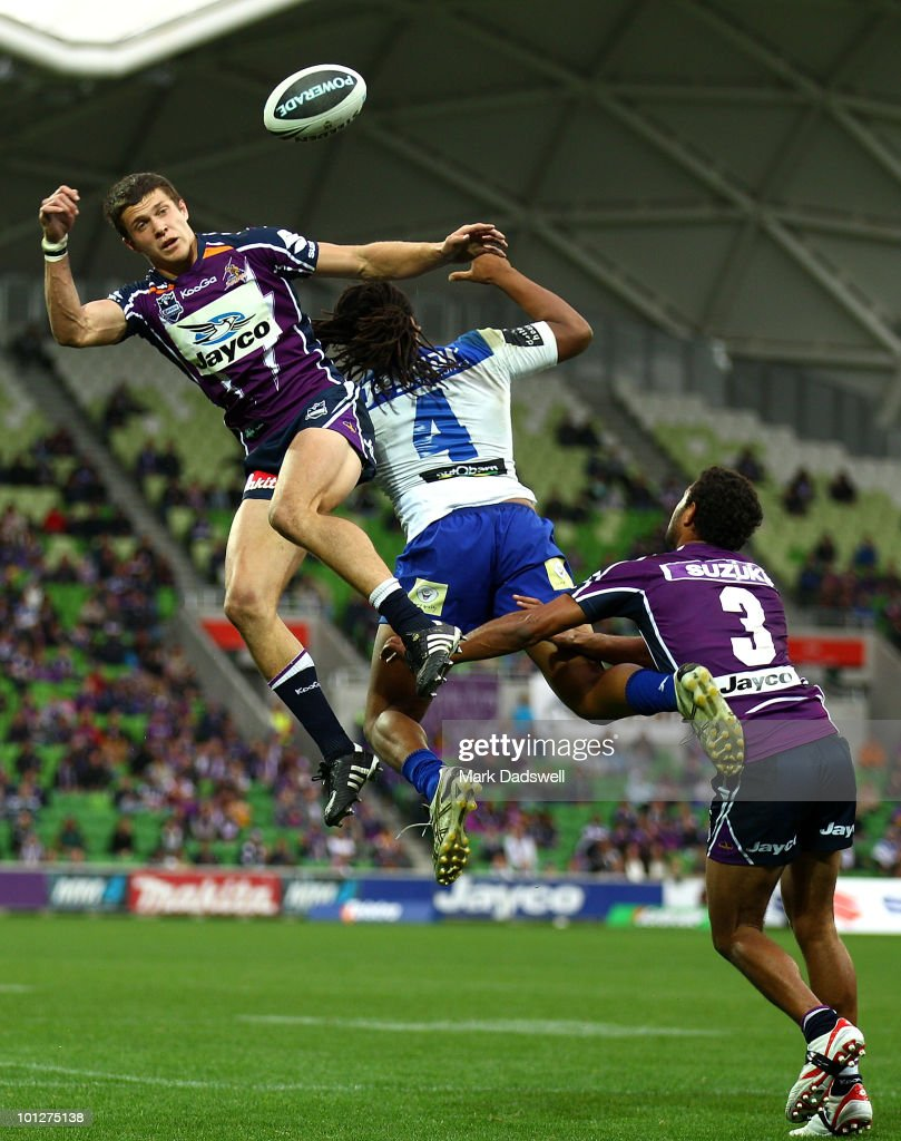 Matt Duffie of the Storm beats Jamal Idris of the Bulldogs in the air during the round 12 NRL match between the Melbourne Storm and the Canterbury Bulldogs at AAMI Park on May 30, 2010 in Melbourne, Australia.